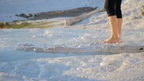 Woman legs in the flowing water in Pamukkale. Woman legs in the thermal waters of Cotton Castle in Pamukkale Turkey stock video