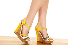 Woman legs green yellow shoes side walk Stock Images
