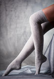 Woman legs in grey stockings Royalty Free Stock Images