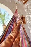 Woman legs in hammock - portrait stock photography