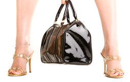 Woman legs and a handbag. On isolated white Royalty Free Stock Image
