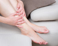 Woman legs and hands stock photography