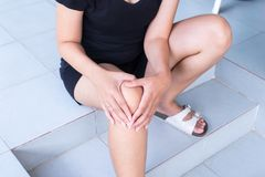 Woman with legs having knee or leg pain,Female feeling exhausted and painful. Woman with legs having knee or legs pain,Female feeling exhausted and painful Royalty Free Stock Photography
