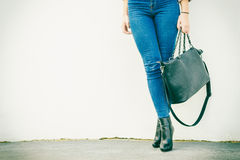 Woman legs in heels shoes handbag in hand Stock Photography