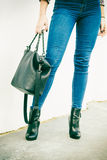 Woman legs in heels shoes handbag in hand Royalty Free Stock Photo