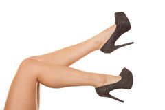 Woman legs heels sparkly shoes Stock Image