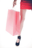 Woman legs in high heel hold shopping bag Royalty Free Stock Images
