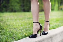 Woman legs and high heels Stock Images