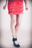 Woman legs in high heels and red dress. Stylish young woman wear fashionable clothes. Long legs in black high heels. Girl in short red dress Royalty Free Stock Photos