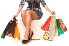 Woman legs in highheels with many shopping bags. Shopping concept. Royalty Free Stock Image