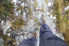 Woman legs with hiking boots on mountain path.Top view Royalty Free Stock Images