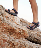 Woman legs hiking on rocks Royalty Free Stock Image
