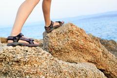 Woman legs hiking on rocks Royalty Free Stock Images