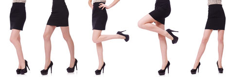 The woman legs isolated on the white Royalty Free Stock Photography