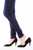 Woman legs in jeans Stock Images