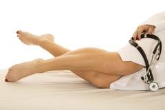 Woman Legs Lay Doctor Coat Stethoscope Crossed Stock Image