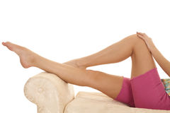 Woman legs lay pink shorts. A woman laying back and showing off her legs Royalty Free Stock Photos