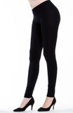 Woman legs with leggings Stock Image