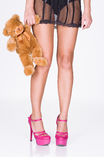 Woman legs, lingerie and teddy bear Royalty Free Stock Photography