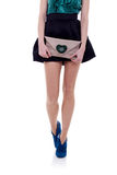 Woman legs and little purse Royalty Free Stock Photography