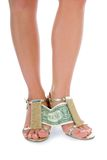 Woman legs with money on white Royalty Free Stock Images