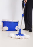 Woman legs with mop and bucket cleaning floor Stock Image