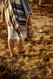 Woman legs in native indian american boho dress walking in windy Stock Photos