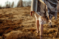 Woman legs in native indian american boho dress walking in windy Royalty Free Stock Image