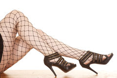 Woman legs net heels. A woman is wearing net tights with heels Stock Images