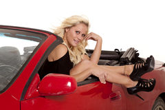 Woman legs out of car smile Royalty Free Stock Photo