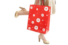 Woman legs with packet run shopping Stock Photos