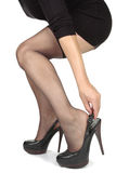 Woman legs  putting on heels  shoes Royalty Free Stock Photo