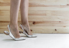 Woman legs putting on shoes Royalty Free Stock Photos