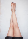 Woman legs raised up high on the wall royalty free stock photography
