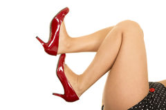 Woman legs with red heels toes up Royalty Free Stock Photography
