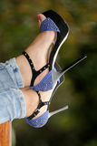 Woman legs in red high heel shoes outdoor shot Royalty Free Stock Image