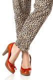 Woman legs and red high heels. Isolated on white background Stock Image