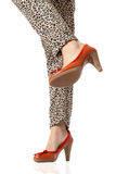Woman legs and red high heels. Isolated on white background Royalty Free Stock Photo