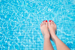 Woman legs with red nail Stock Photography