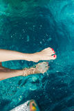 Woman legs with red nail in swimming pool Royalty Free Stock Photo