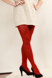 Woman legs in red vivid color pantyhose black high heels shoes Stock Photos