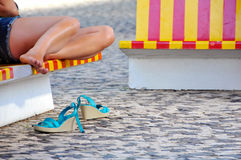 Woman legs resting after a walk through the city Stock Photography