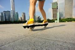 Woman legs riding on ripstick Stock Photo