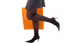 Woman Legs Run Shopping With Paper Bag Royalty Free Stock Photography
