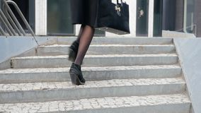 Woman legs running up the stairs stock video footage