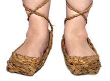 Woman legs in russian bast shoes Royalty Free Stock Photo