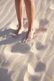 Woman legs on sand beach Royalty Free Stock Photos
