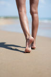 Woman legs at sand Stock Image