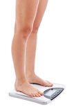 Woman legs with scales Royalty Free Stock Image
