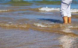Woman legs in the sea Stock Photo